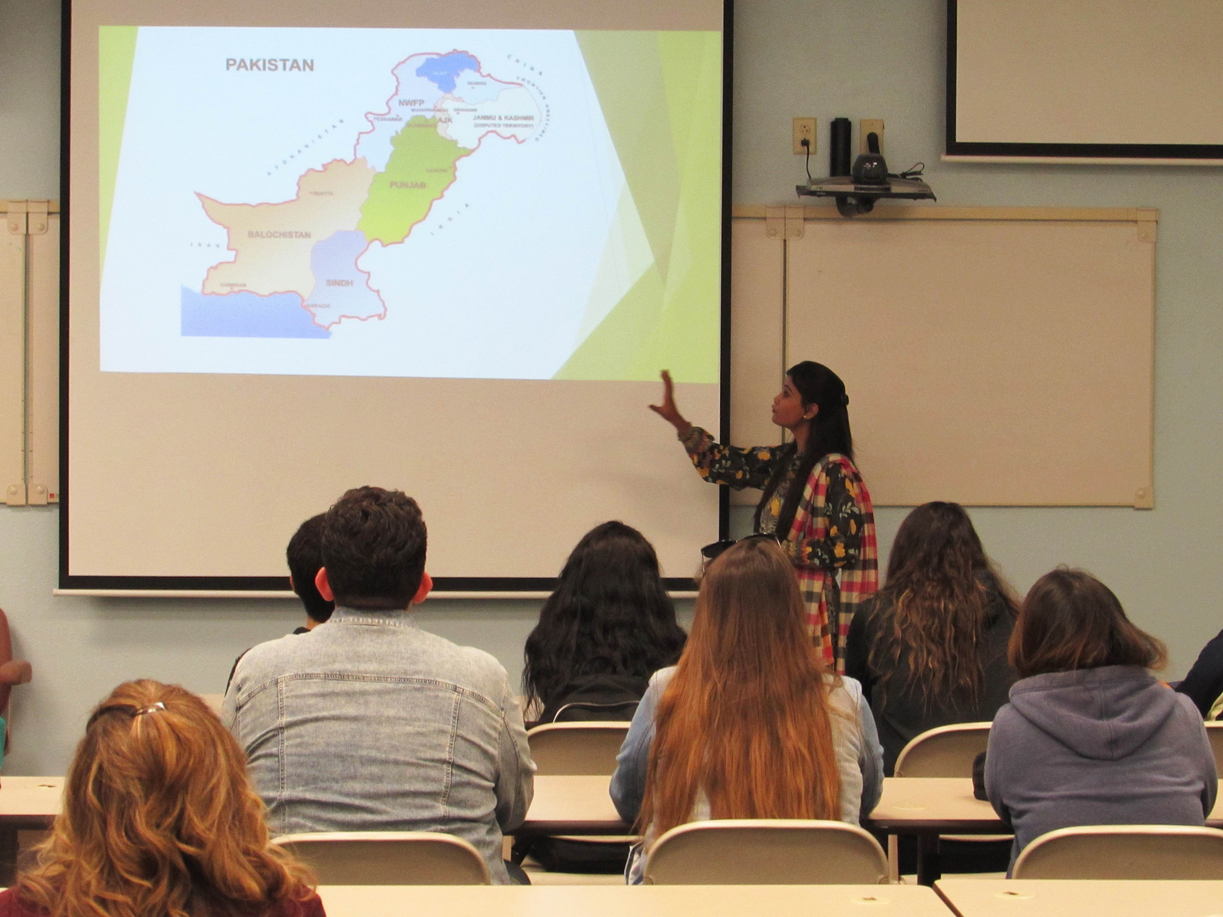 A student is presenting on Pakistan to a group of students