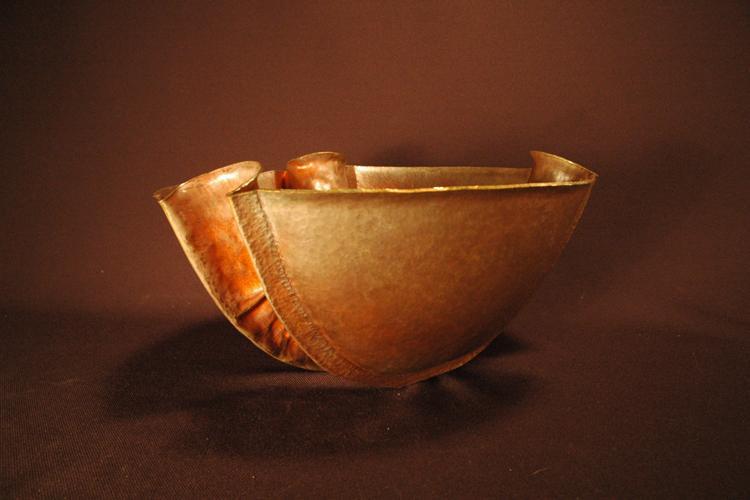 Copper bowl displayed at the symposium.