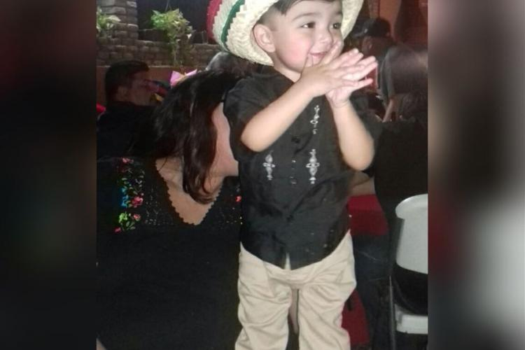 image of a boy in a Mexican-themed hat