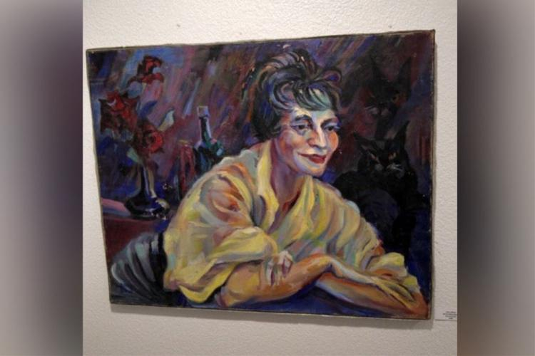 Portrait of woman leaning forward in yellow blouse
