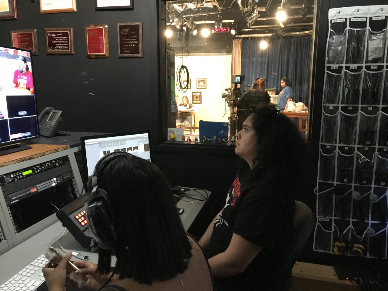 Students are seated by computers, working on the production of the show